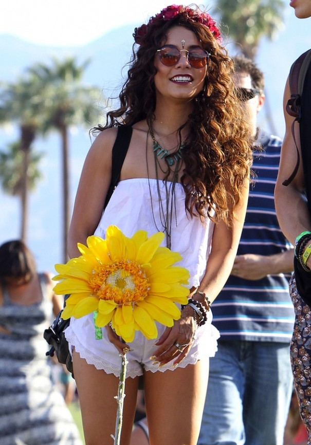 **EXCLUSIVE**  Vanessa Hudgens enjoys the Coachella music festival with her boyfriend Austin Butler while carrying a giant yellow flower