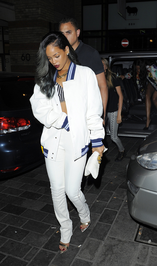 rihanna-cirque-du-soir-london-roberto-cavalli-white-varsity-jacket-pants-sandals[1]