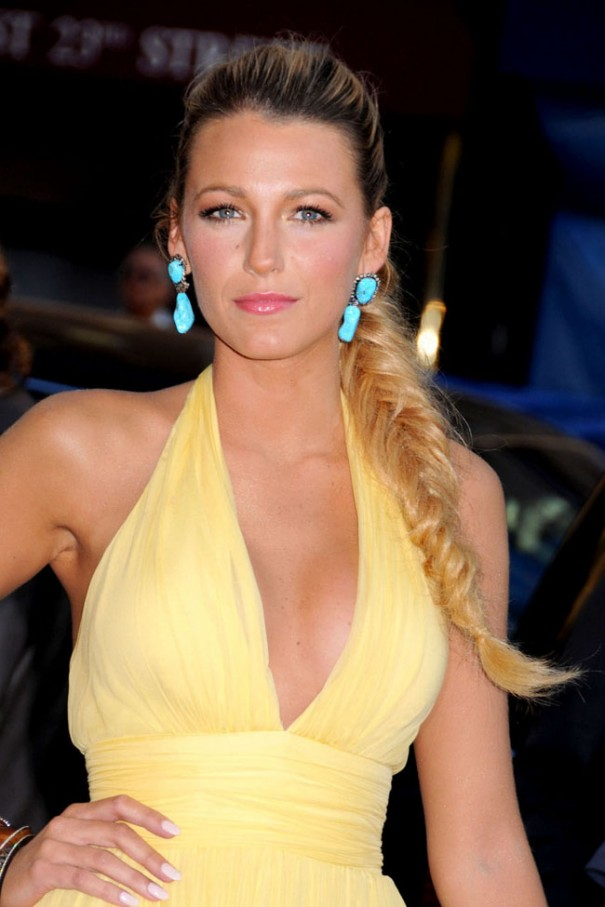 Blake Lively stuns in a plunging yellow dress paired with turquoise earrings and a fishtail braid at the New York premire of 'Savages'